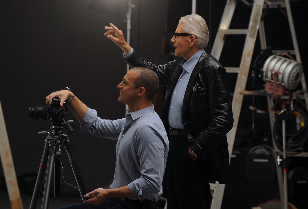 . Art Van Elslander, owner of Art Van Furniture and internationally renowned photographer Nigel Barker during a photo shoot for one of several furniture catalogues. The Macomb Daily File Photo/DAVID DALTON