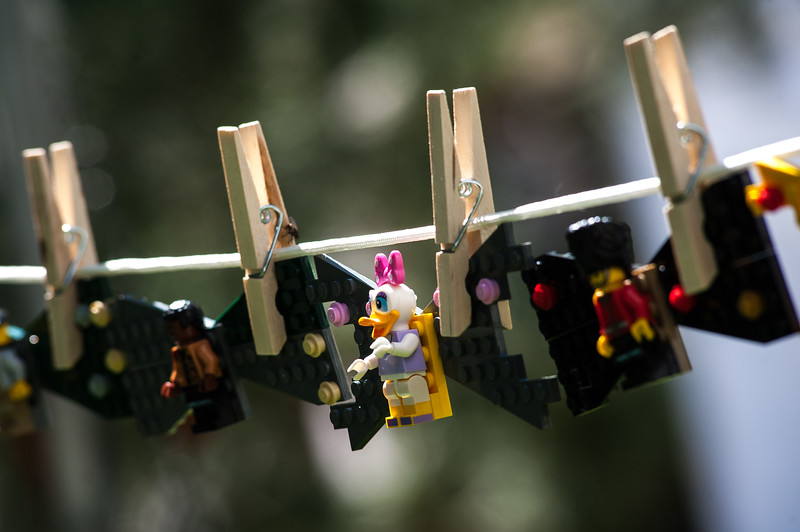 Lego bow ties hang in the Son and Pop Bow Tie Shop during Art in the Park in North Lake Park on Sunday, August 13.