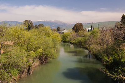 Snowy peak of Mount Hermon in the early spring in Israel via Jordan River.