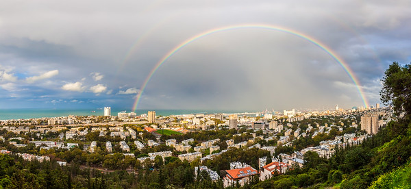 Double Rainbow over the city on Mediterranean coast. Haifa bay. Israel.
