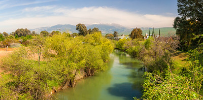 Snow on Hermon Mount in spring. Beautiful panoramic landscape of the mountains of Galillee and Golan Heights via Jordan River. Israel