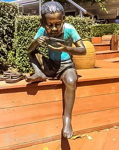 Statue of a workman (boy) drinking tea