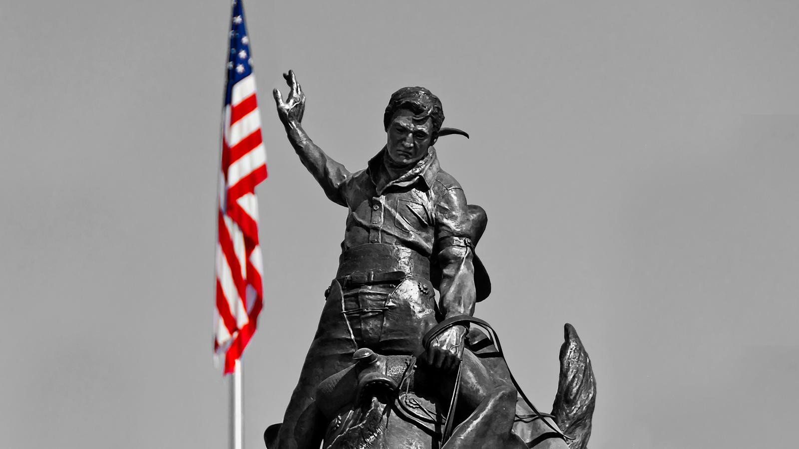 bronze statute bw and flag