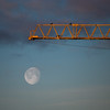 Two crows on a crane - and a moon