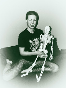 Rita is almost as bald as the skeleton!