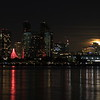 Rising moon over San Diego skyline