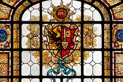 Stained glass at the MAH with the flags and arms of the city of Geneva