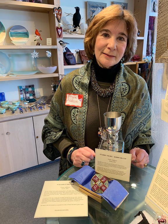. Artist Frann Addison of Acton holds her �Starry Night-Kiddush Cup� and Scrabble Dreidel in honor of her son, Josh.