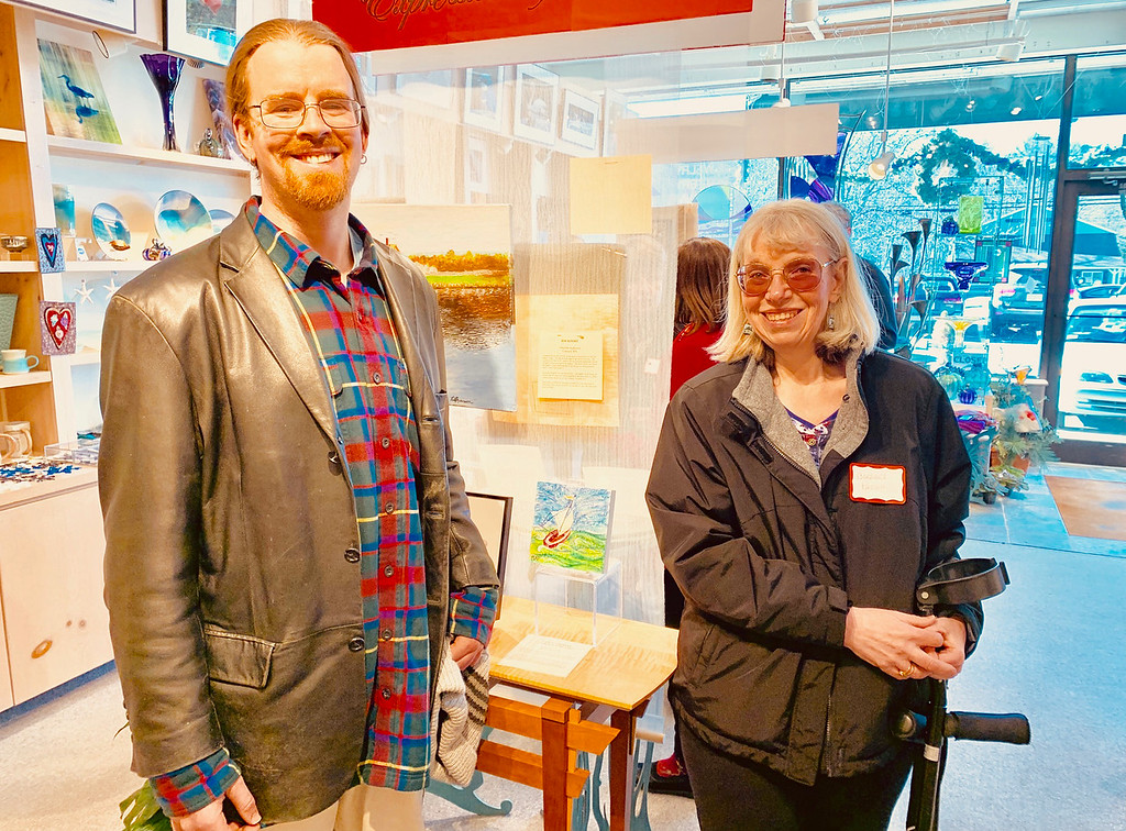 . Erik Beaverson of Acton with artist Barbra Paugh of Boxboro, who made for Erik �The Little Sailboat �.. and music is her name.�