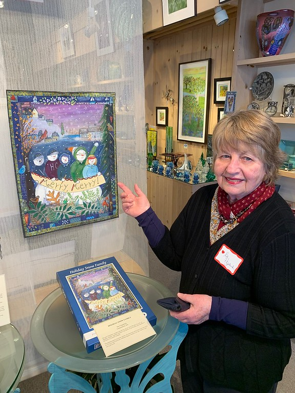 . Artist Pat Fitzpatrick of Chelmsford displays her quilt and book, �Holiday Snow Family.�