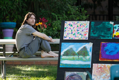 Arthur Herrer sits and listens to live music during the annual Art on the Green Wednesday September 14, 2016 at the Joe McGie Center in Chico, Calif. The art show featured work by clients of the Work Training Center, live music and food. All proceeds from the art sale benefited the Joe McGie Center, a division of the Work Training Center.Wednesday September 14, 2016 in Chico, Calif. (Emily Bertolino -- Enterprise-Record)