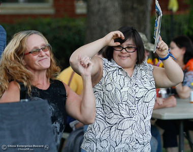 Lisa Lamphere and Chele Landry get down and groove to the Moon Bears during the annual Art on the Green Wednesday September 14, 2016 at the Joe McGie Center in Chico, Calif. The art show featured work by clients of the Work Training Center, live music and food. All proceeds from the art sale benefited the Joe McGie Center, a division of the Work Training Center.Wednesday September 14, 2016 in Chico, Calif. (Emily Bertolino -- Enterprise-Record)