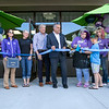 Leominster Mayor Dean Mazzarella, in suit, watches as Art on the Rocks Owner Stacey Sparrow and her daughter Mckynlie Murphy, 9, cut the ribbon at their opening on Friday, September 3, 2021 in Leominster. To the Left of the mayor is owner of the building Paul DiGeronimo. SENTINEL & ENTERPRISE/JOHN LOVE