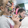 Painting a skull at the Art on the Rocks ribbon cutting in Leominster is Janelle Mayou, 6, from Lancaster. SENTINEL & ENTERPRISE/JOHN LOVE