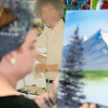 """Stacey Sparrow Murphy in her shop """"Art on the rocks"""" in Fitchburg shows how to paint like Bob Ross on Friday, September 27, 2019. A cardboard cutout of Ross stands in the corner as she paints. SENTINEL & ENTERPRISE/JOHN LOVE"""