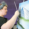 """Stacey Sparrow Murphy in her shop """"Art on the rocks"""" in Fitchburg shows how to paint like Bob Ross on Friday, September 27, 2019. SENTINEL & ENTERPRISE/JOHN LOVE"""