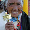 Tibetan woman in Tagong with Prayer Wheel. She asked me for money after I took this picture.