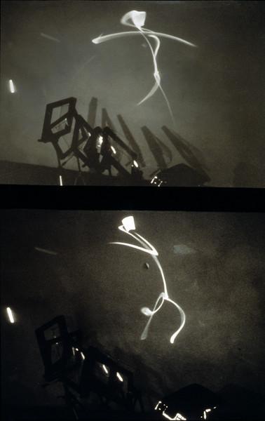 stick figures. aluminum, Mylar, tripods and light source, 7'h x 4'w x 8'l, 1997.