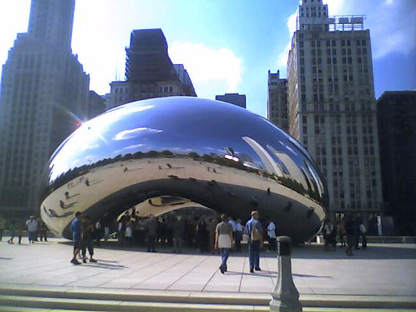 """Standard postcard shot.<br /> <br /> According to my tour guide, Kapoor never names a work until it's finished, but long before that happened Chicagoans named it """"The Bean,"""" and that seems to have stuck as durably as anything."""