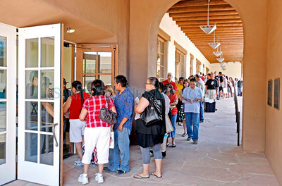 People line up for the Indian Market check-in at the Santa Fe Community Convention Center on Aug. 18, 2010.             Luis Sanchez Saturno/ The New Mexican.