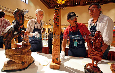 Judging at Indian Market, held in the Santa Fe Community Convention Center in Santa Fe, N.M. on Aug. 19, 2010. (L-R) Dan Prall, Kathy Whitman, Daniel Weahkee, and Jim Enote Natalie Guillén/The New Mexico