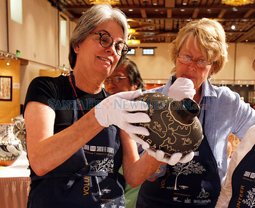 Judging at Indian Market, held in the Santa Fe Community Convention Center in Santa Fe, N.M. on Aug. 19, 2010. (L-R) Jane Aebersold and Nancy Blomberg Natalie Guillén/The New Mexico