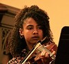 Jaxine Wolfe played Bach beautifully. In addition to being a fine violinist, she is a marine and environmental scientist.