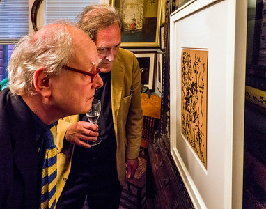 Martin Muller looking at front of Jackson Pollock silk screen print acquired by Robert