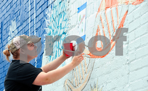 """photo by Sarah A. Miller/Tyler Morning Telegraph  University of Texas at Tyler graduate art student Briana Sutton of Mineola works on turning the outside of Tyler's Discovery Science Place into a large mural Friday. The project is part of the art/mural painting class at the school taught by professor Alexis Serio.  The expected completion date of the mural is Friday, May 3. An on-site ribbon cutting ceremony will be announced.   """"This art course provides an exciting opportunity for our students to work as a team and explore the demands and rewards of art as a community service,"""" said Alexis Serio, UT Tyler professor of art and course leader. In describing the mural she said, """"We wanted to create a blueprint theme to reflect the science going on inside the building."""""""