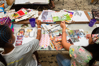Campers Olive Brookshire (left) and Dane Santos create Picasso-inspired collages made out of old magazine clippings during Petite Picasso camp Tuesday in the Jenkins Building at Tyler Junior College.   (Cara Campbell/Tyler Morning Telegraph)