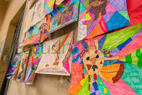 Picasso-inspired drawings of a dogs hang on display during Petite Picasso camp Tuesday in the Jenkins Building at Tyler Junior College.   (Cara Campbell/Tyler Morning Telegraph)