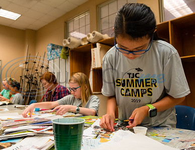 Eleven-year-old Chloe De Ynchausti builds a Picasso-inspired collage out of old magazine clippings during Petite Picasso camp Tuesday in the Jenkins Building at Tyler Junior College.   (Cara Campbell/Tyler Morning Telegraph)