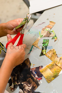 Eight-year-old Sarah Weissmann cuts out photos from a magazine to use in her Picasso-inspired collage during Petite Picasso camp Tuesday in the Jenkins Building at Tyler Junior College.   (Cara Campbell/Tyler Morning Telegraph)