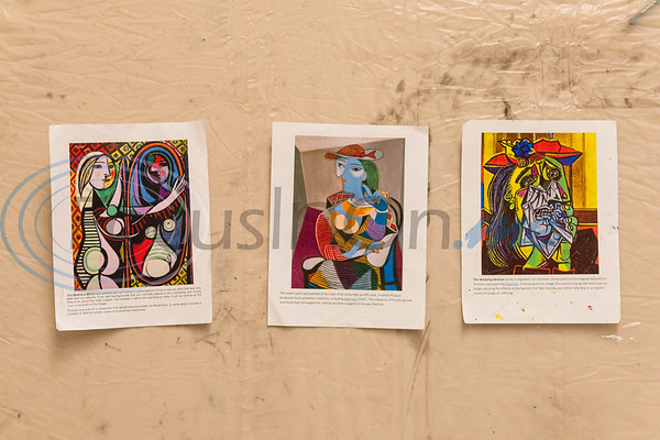 Prints of Picasso's artworks hang on the wall to inspire campers' creations during Petite Picasso camp Tuesday in the Jenkins Building at Tyler Junior College.   (Cara Campbell/Tyler Morning Telegraph)