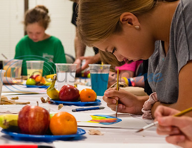 Fourteen-year-old LilyAnn Weissmann creates a still-life portrait of a plate of fruit using watercolor paint during a Watercolor and Acrylic camp Tuesday in The Ornelas Health & Physical Education Center at Tyler Junior College.   (Cara Campbell/Tyler Morning Telegraph)