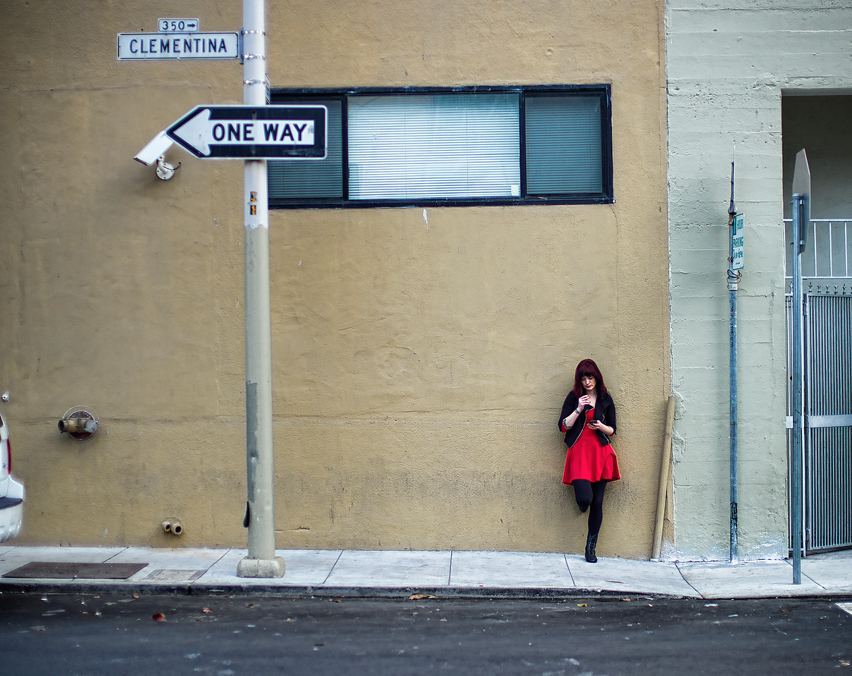 The girl in red.  Clementina Street, San Francisco.