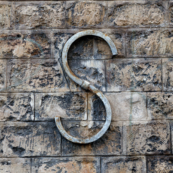 """S"" on an old wall"