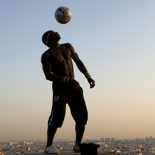 """I"" man with soccer ball"