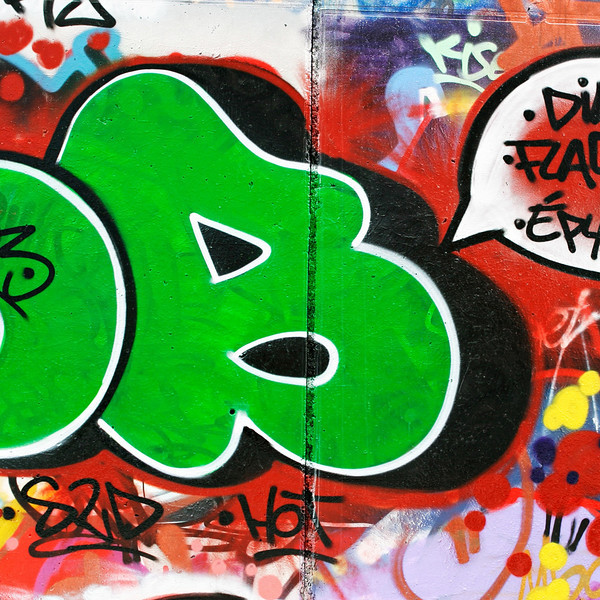 """B"" a beautiful detail of graffiti."