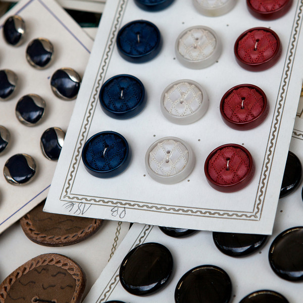 """O"" buttons at a flea market"