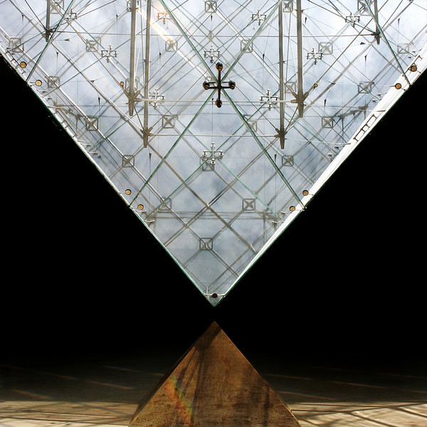 """V"" The inverted pyramid refracting light at the Louvre"