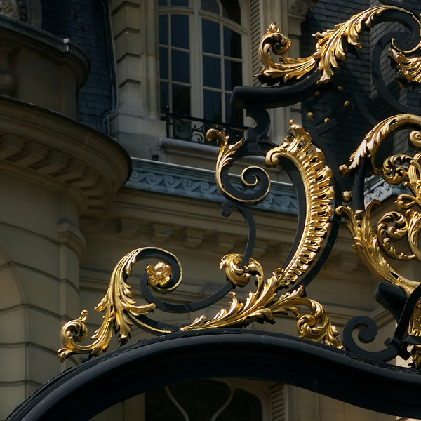 """J""  Detail of an ornate iron gate"
