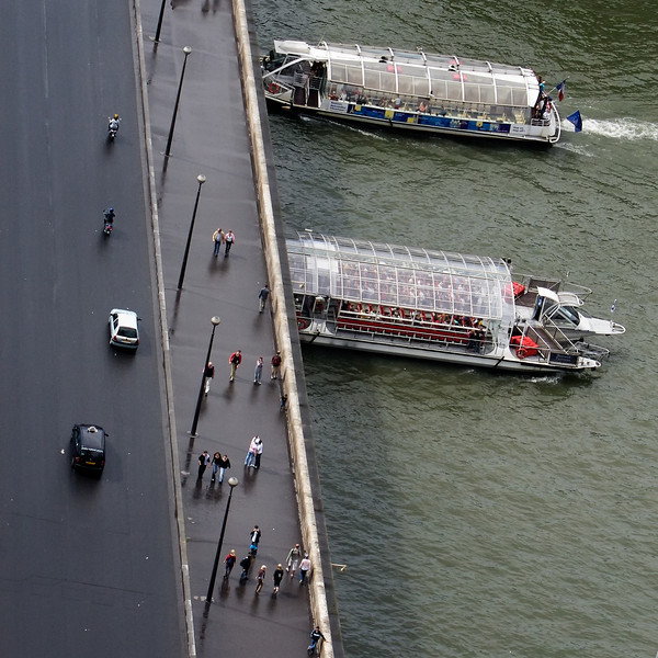 """""""F"""" two boats touring the Seine as seen from the Eiffel Tower"""