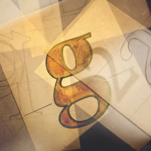 """G"" from a window display takes on a cubist feel in this photo"