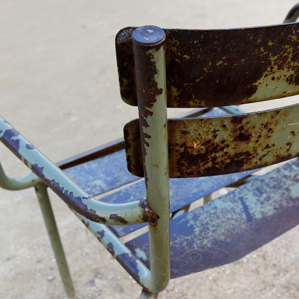 """""""F"""" well worn chair in the Jardin du Luxembourg"""