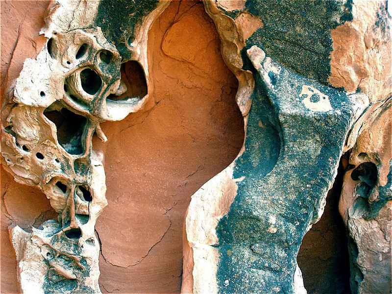"""Calavera"" - Homage to Diego Rivera, and ""Kikimora"" (Russian hobgoblin) Note<br /> under the scull of the Calavera the image of the Shaman is lurking. Red<br /> sandstone cave. Mohave desert, Nevada."