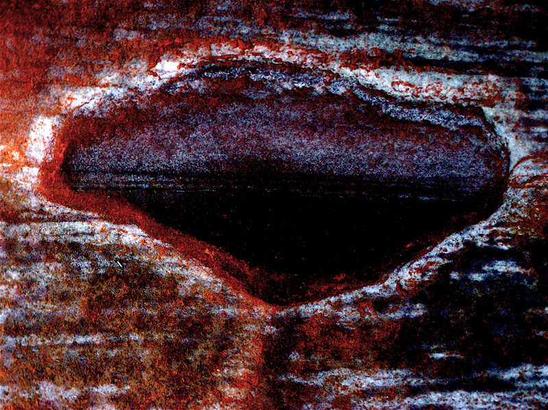 "'Window Into Eternity."" Dark Red Sandstone Wall in a Cave. Flash! Mohave<br /> Desert, Nevada"