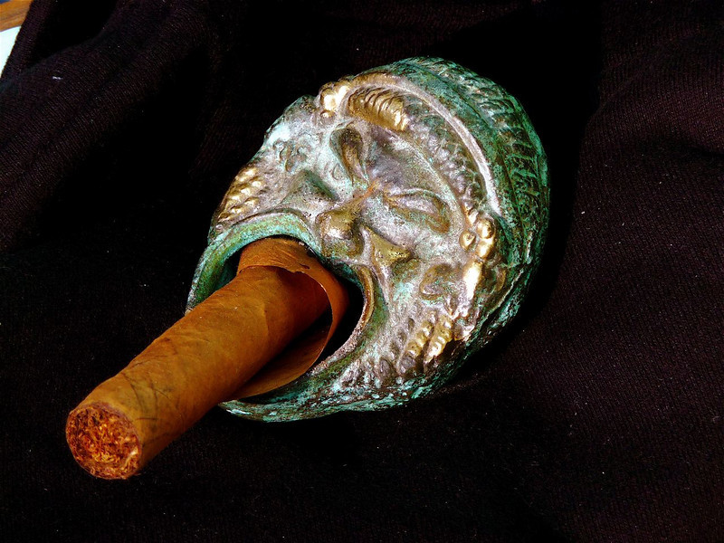 """Penetration"" or ""Ashes of a Love."" Ash tray from Sicily - Silenus, son of Bacchus; cigar still incandescent!"