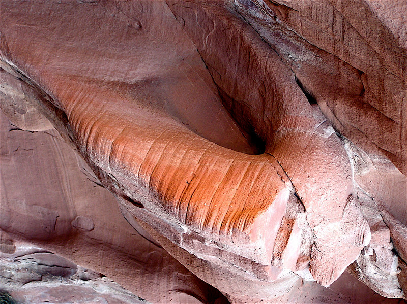 """""""On the Beach"""" Red Sandstone. Notice the Roman Legionnaire's head and helmet in the upper left corner! Homage to Dali."""