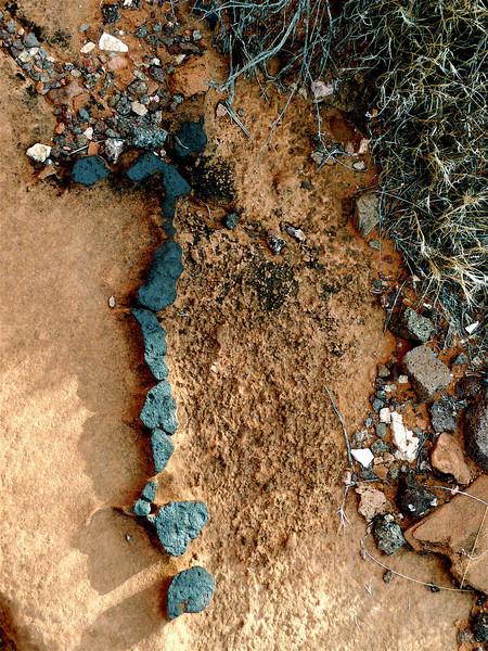 """The Mystical Letter""  Spiritus meus attenuabitur, dies mei breuiabuntur, solum mihi superest sepulchrum. Iob XVII.<br />     Greenish diabase rocks glued into the sand forming number 7; at sunset,<br /> 4.58 PM. 12/13/2007. Mohave Desert. North of Lake Mead, Nevada."